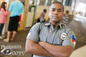 School security guard assisted by security cameras